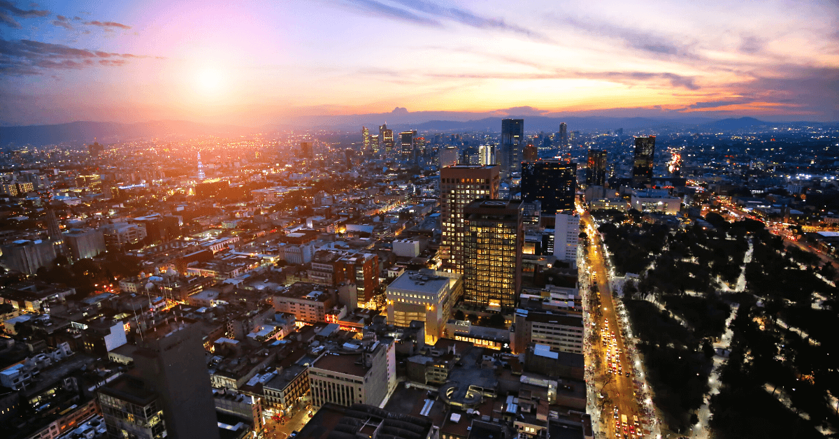 beautiful city landscape at sundown showing buildings and steets from birds eye view