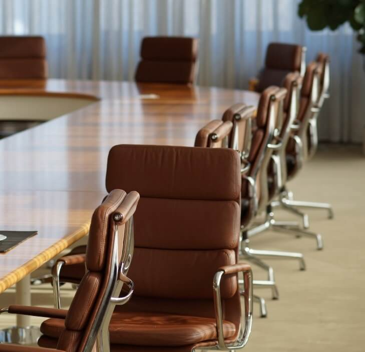 Empty office with brown leather chairs